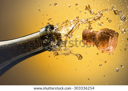 Opening a bottle of champagne. Celebration concept. - stock photo