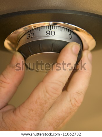 Opening a combination lock on a safe.