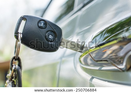Opening car door - stock photo