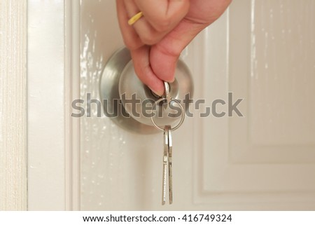 Opening door with Key insert and hold in stainless steel round ball door knob - stock photo
