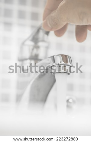 Opening Faucet In The Bathroom - stock photo