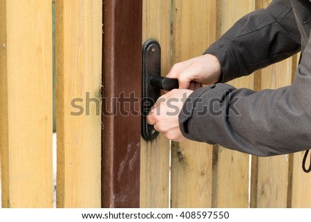 opening home door by bunch of keys close up