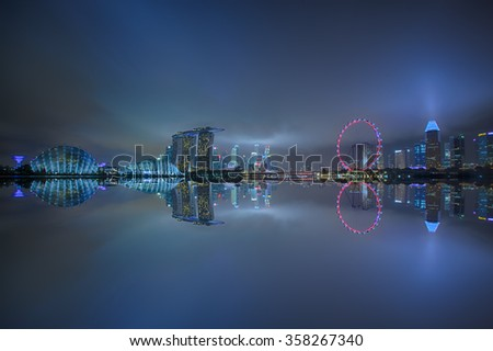 Opening new year festival, Marina bay business office during twilight with water reflection, Singapore.(soft focus due long exposure,high iso,multi focus) - stock photo