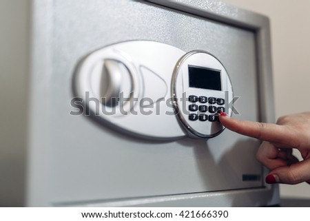 Opening of a safe by typing in security code - stock photo