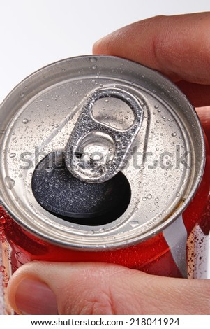 Opening soda cola can. Holding soda cola can.Hand opening soda can.
