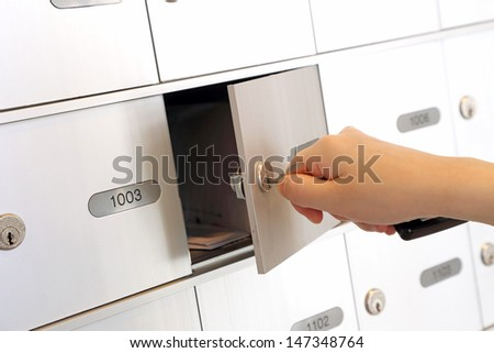 Opening the mailbox - stock photo