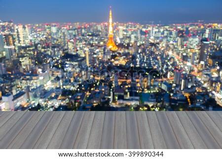Opening wooden floor, Blurred bokeh lights background, Tokyo city downtown, Japan  - stock photo