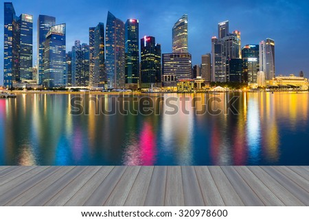 Opening wooden floor, Singapore Marina Bay Business District water reflection - stock photo