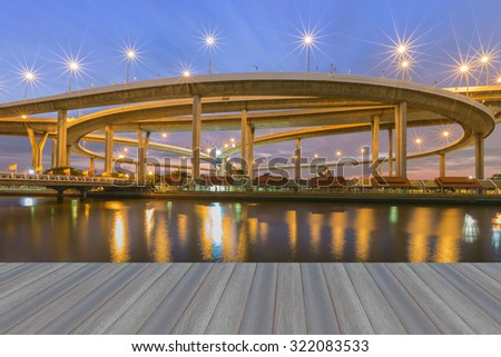 Opening wooden floor, Suspension Bridge across the river at twilight, The Industrial Ring Road (Bangkok, Thailand)