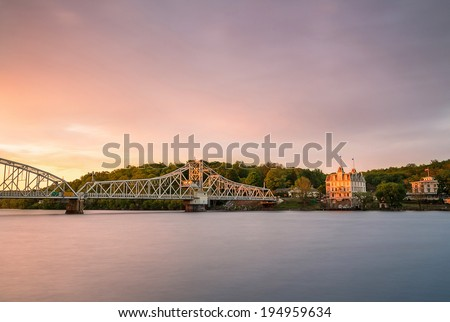 Opera house with a swinging bridge at sunset