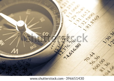 Operating budget and black compass in closeup - stock photo