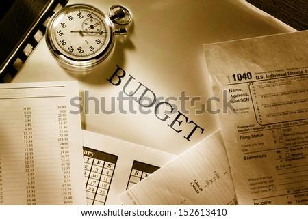 Operating budget, calendar and stopwatch - stock photo