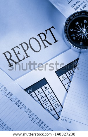 Operating budget, calendar, compass and report - stock photo