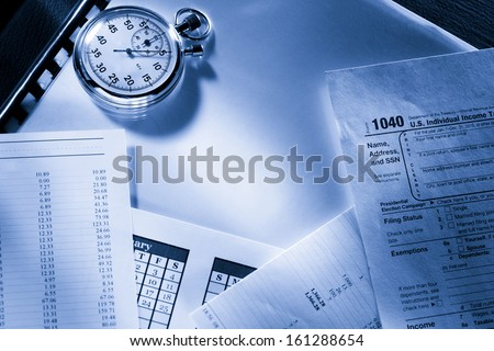 Operating budget, calendar, stopwatch and tax form - stock photo