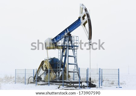 Operating oil and gas pump isolated on snow white background  - stock photo