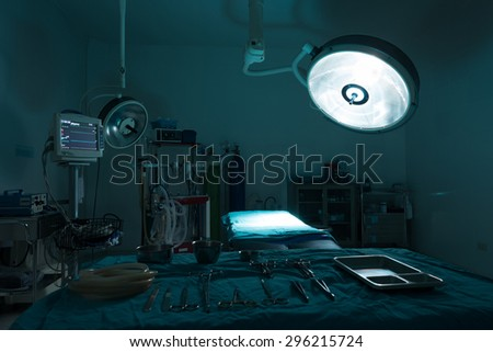 operating room with equipment in hospital , blue filter - stock photo