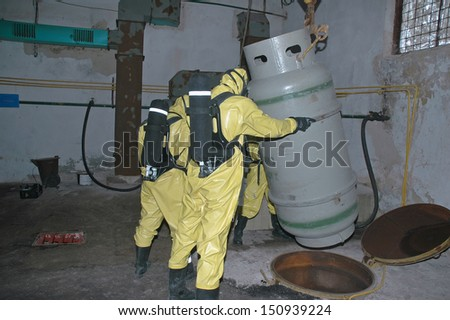 operation of chemical protection Emergency, recycling barrels with chemical - stock photo
