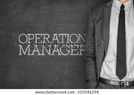 Operations manager on blackboard with businessman in a suit on side