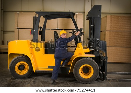 Operator getting on the forklift to work - a series of METAL INDUSTRY images.