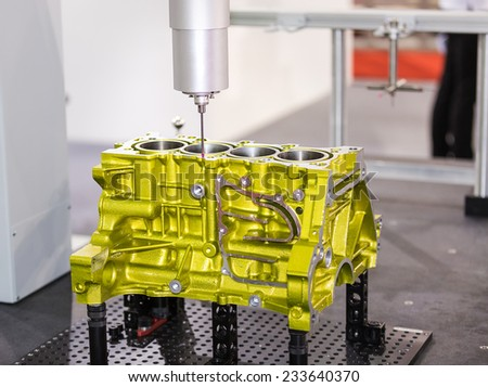 operator inspection dimension aluminium automotive part  by CMM after machining in industrial factory - stock photo