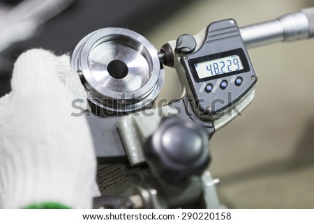 operator inspection high precision automotive part by micrometer - stock photo