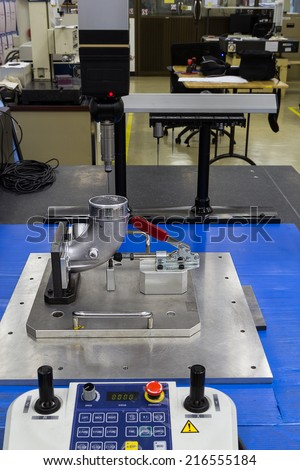 operator measuring machining parts by cmm machine - stock photo