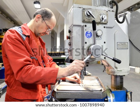 operator of a drilling machine in a industrieal company