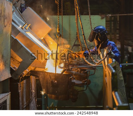 operator recieve molten metal from melting furnace  - stock photo