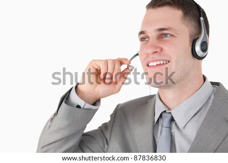 Operator using a headset against a white background