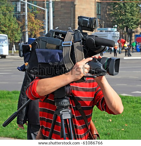 operator with camera on town street - stock photo