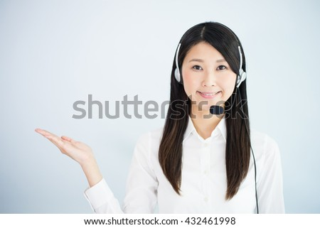 operator woman with headset against light blue background - stock photo