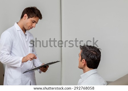 Ophthalmologist and patient talking - stock photo