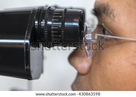 ophthalmologist use eye test machine.