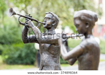 Opole - Poland - July 23. Sculptures of musicians at the Philharmonic of Opole in Opole. Author Robert Sobocinski. Opole - Poland - July 23, 2015 - stock photo
