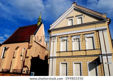 Opole, Poland - June 16, 2010:  Church of St. Sebastian (left) and  19th century neo-classical house