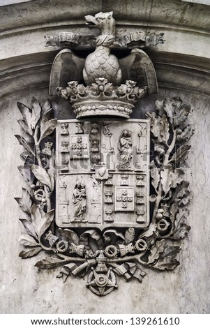Oporto, December 2012. Coat of arms. Legend: Cidade Invicta. - stock photo