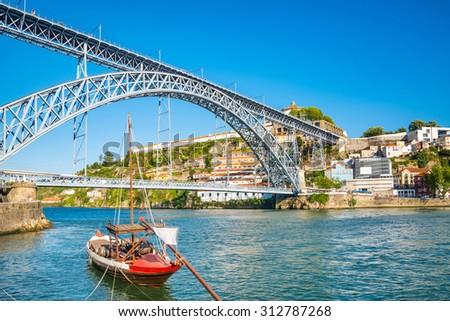 Oporto or Porto city skyline, Douro river, traditional boats and Dom Luis or Luiz iron bridge. Portugal, Europe. - stock photo