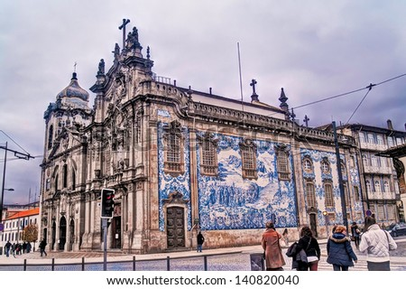 OPORTO, PORTUGAL - DECEMBER 3: Carmo church on December 3, 2012 in Oporto, Portugal.  1756 - 1768 Figueiredo Seixas baroque style. National Monument. Glazed tiled facade Silvestre Silvestri 1912. - stock photo