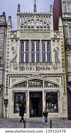 OPORTO, PORTUGAL - DECEMBER 3: Livraria Lello bookstore facade on December 3, 2012 in Oporto, Portugal. 1906 Francisco Xavier Esteves on neogothic style. - stock photo