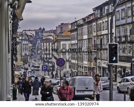 OPORTO, PORTUGAL - DECEMBER 3: Street at downtown on December 3, 2012 in Oporto, Portugal. UNESCO World Heritage Site. Buildings and people. - stock photo