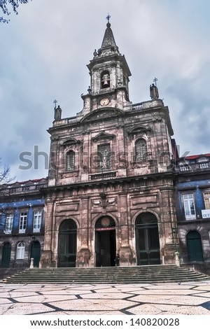OPORTO, PORTUGAL - DECEMBER 3: Trinity church on December 3, 2012 in Oporto, Portugal. 1841, architect Carlos Amarante.  UNESCO World Heritage Site (Oporto historic area) - stock photo