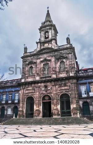 OPORTO, PORTUGAL - DECEMBER 3: Trinity church on December 3, 2012 in Oporto, Portugal. 1841, architect Carlos Amarante.  UNESCO World Heritage Site (Oporto historic area) - stock photo