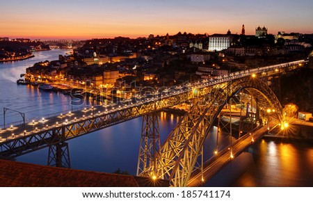 Oporto - river Douro an Dom Luis bridge after sunset - stock photo