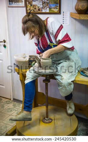 OPOSHNYA, UKRAINE-SEPTEMBER 21: Art exhibition of pottery  on september 21, 2014 in Oposhnya, Ukraine. Potter at work. - stock photo