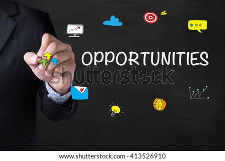 OPPORTUNITIES Businessman drawing Landing Page on blurred abstract background - stock photo