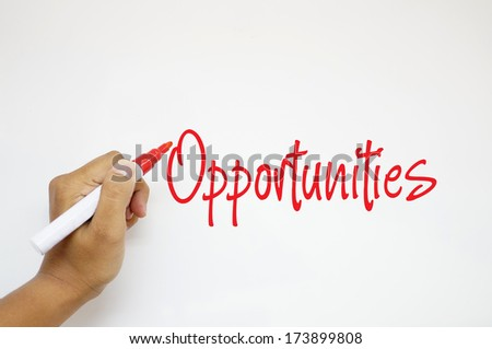 Opportunities sign on whiteboard - stock photo