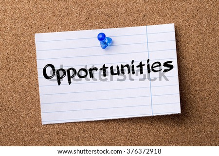 Opportunities - teared note paper  pinned on bulletin board - horizontal image - stock photo