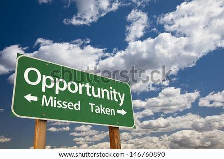 Opportunity Missed and Taken Green Road Sign Over Dramatic Blue Sky and Clouds. - stock photo