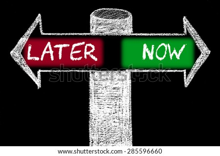 Opposite arrows with Later versus Now.Hand drawing with chalk on blackboard. Choice conceptual image - stock photo