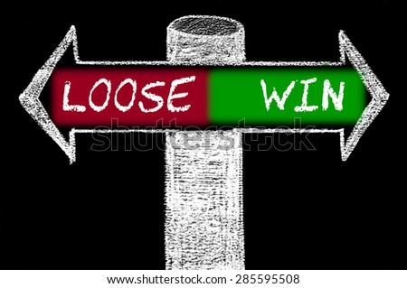 Opposite arrows with Loose versus Win.Hand drawing with chalk on blackboard. Choice conceptual image - stock photo